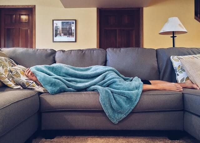 person sleeping on couch